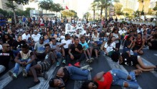 Protesters hold a sit-in during a protest against police brutality targeting Israelis of Ethiopian descent, Tel Aviv, July 3, 2016.