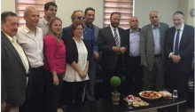 Former Saudi General Anwar Eshki, fourth from right, and other members of a delegation of Saudi academics and business people meet with Israeli Knesset members, July 22, 2016.