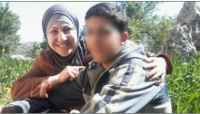 A Palestinian mother together with her minor son being held by Israel in administrative detention (Photo: B'Tselem)