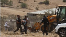 Police arrest a youth from Umm al-Hiran as construction crews prepare to build a fence around village homes, July 31, 2016.