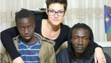 Ruth Berdah-Canet and two Sudanese refugees in South Tel-Aviv