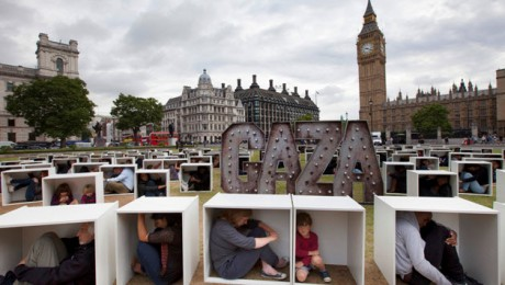 At Parliament Square in London on August 14, 2014, 150 men, women and children crammed themselves into boxes to illustrate the conditions faced by the people in Gaza who are trapped by the blockade. The event was organized by Oxfam.