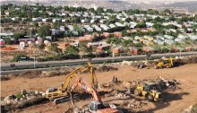 Heavy construction machinery work as the building of a housing project resumes in the occupied West Bank Israeli settlement of Ariel