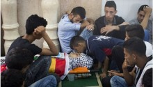 Mourners gather around the body of Palestinian Muhammad Abu Hashhash, who was shot dead during clashes with the Israeli army a day earlier, during his funeral on August 17, 2016 in the al-Fawwar Palestinian refugee camp, south of the West Bank city of Hebron