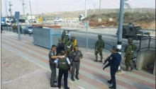 Israeli forces gather at the Za'atara checkpoint after a Palestinian woman, Rahiq Birawi, was shot and killed by border police on October 19, 2016.