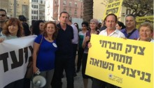 MK Dov Khenin (center) during a demonstration for Holocaust survivor rights in Israel held in Tel-Aviv