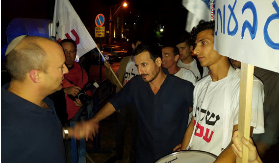 A Peace Now demonstration in Raanana, last Tuesday evening, November 15, outside the home of Minister of Education, Naphtali Bennet, the sponsor of the Outpost Regulation Bill
