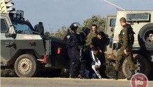 Israeli forces arrest a Palestinian demonstrator on Saturday, January 7, in the Qalqiliya district of the northern occupied West Bank.