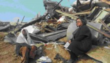 Leading CPI activist, MK Aida Touma-Sliman (Joint List - Hadash) sits among the ruins of one of the homes destroyed in Umm Al-Hiran, last Wednesday, January 18.