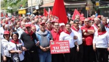 Hadash MKs Dov Khenin (center in red shirt), Ayman Odeh (to Khenin's right), and Aida Touma-Sliman (far right) along with the Secretary General of the Communist Party of Israel Adel Amer and leading CPI activist Mohammed Barakeh (third and second from the right, respectively) during the May Day march in Nazareth, last Saturday, April 29