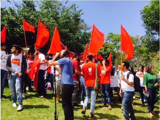 Hadash students commemorating May Day in a demonstration for maintenance workers' rights at the University of Haifa, May 4, 2017
