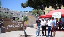 MK Odeh, second from right, in front of the solidarity tent erected in Nazareth