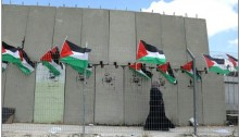 Palestinian activists broke into the Ofer military court grounds in the occupied West Bank to hang flags and draw graffiti of Marwan Barghouti.