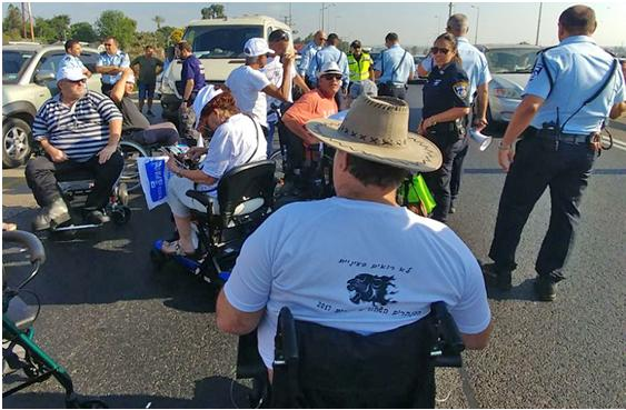 Wheelchair bound protesters at the Batzra Interchange on Route 4 on Sunday morning, July 9