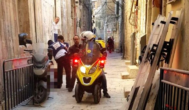 Paramedics nearby an entrance to the compound where the deadly incident took place in Jerusalem on Friday, July 14