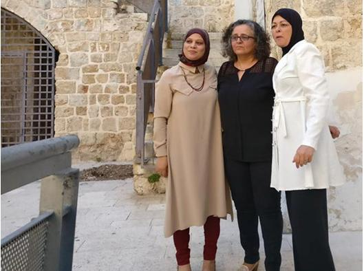 """MK Touma-Sliman (center) with relatives of murdered women at the """"She is Gone"""" exhibition in Tel Aviv, last Sunday July 16"""