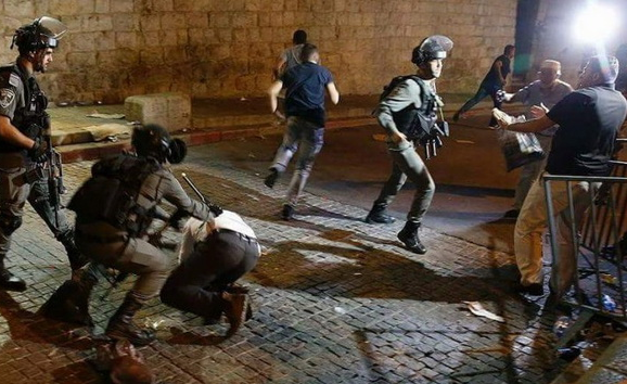 Israeli Border Police confront Palestinian residents of East Jerusalem on Thursday night, July 20.