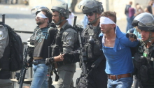 Palestinians arrested in Wadi Joz, occupied East Jerusalem, after police attacked more than two thousand participants in Friday midday prayers outside the al-Aqsa Mosque following Israel's recent provocation of installing electronic security gates just in front of its entrance, July 21, 2017
