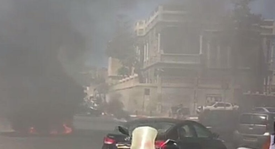 Tires set ablaze on Yefet Street in Jaffa to protest the shooting death of 22-year-old Mahdi al-Saadi by police on Saturday, July 29