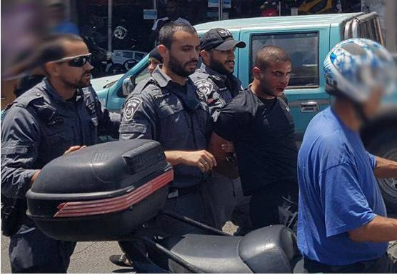 Police arrest the brother of Mahdi al-Saadi (second from right) on Thursday morning, August 3, in Jaffa.