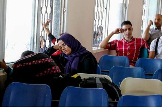 Palestinians waiting at the Rafah Crossing