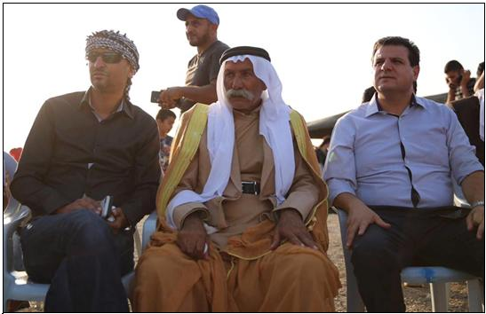 MK Odeh (first from right) with al-Araqib Sheikh Siah al-Touri (center) during a meeting with dozens of activists and residents held in the village to commemorate the 7th anniversary of the village's first demolition, August 17, 2017