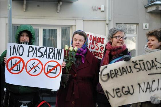 "Antifascist and anti-Nazi protest in Vilnius, Estonia, January 2013. The full text of the sign at the right (only partially visible on the photo) reads: ""Better shit on the head than Nazis in the government."""