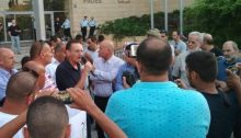 MK Khenin in front of the Jaffa police precinct during the last Saturday's demonstration against police violence
