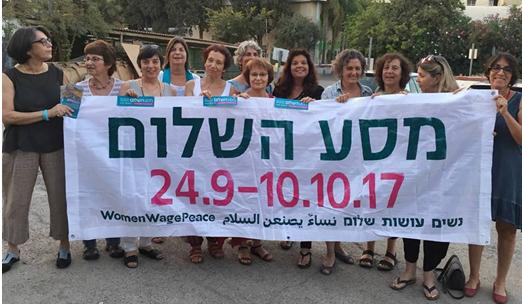 Women Wage Peace activists with a banner for their two-week march for peace