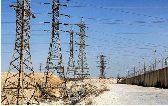 Israel Electric Corporation power lines located inside the village of Wadi el-Na'am, but which only provide electricity to nearby chemical plants