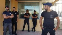 Security guards prevent employees from entering the Negev Ceramics plant