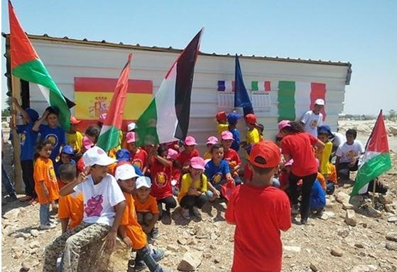 Children from Umm Jabal gather to protest the demolition of the only kindergarten there.