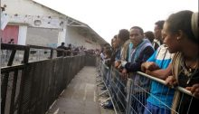 Asylum seekers in Tel Aviv waiting in line to submit applications for asylum