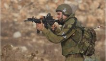 Israeli soldier shoots live ammunition directly at protesters during clashes in the weekly demonstration against the occupation in Nabi Saleh, West Bank, November 2, 2012.