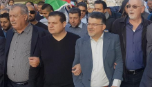 From left to right, Mohammed Barakeh, Joint List chairman MK Ayman Odeh, Hadash MK Youssef Jabareen and former Hadash MK Issam Makhoul, lead protesters in the march in Sakhnin, Friday, December 15.