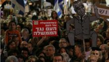 "A demonstrator participating in last Saturday night's anti-corruption protest in Tel Aviv carries one of Hadash's anti-government placards: ""When the government is against the people, the people are against the government."""