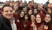 MK Ayman Odeh with students from Umm el-Fahem, on Monday, December 18, during a visit by the young women to the Knesset in Jerusalem