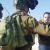 MK Ayman Odeh confronts occupation soldiers near Nabi Saleh on Saturday, January 14