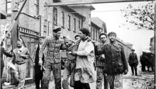 Inmates at the main gate of the Auschwitz death camp in Poland after its liberation by the Red Army