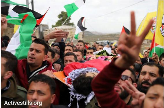 The funeral of Mus'ab a-Sufi, 16, in the village of Deir Nidham, near Nabi Saleh, in the West Bank, January 4, 2018. During the funeral, Muhammad 'Awad, 19, from the village of 'Abud, was shot in the head and severely wounded by an Israeli soldier.