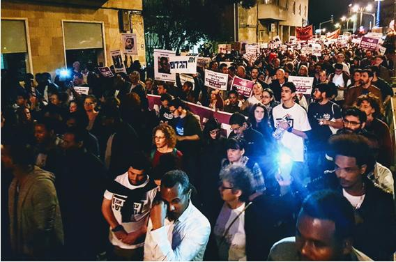 Thousands marched through Jerusalem on Saturday night calling on the far-right government to halt plans to deport African refugees.