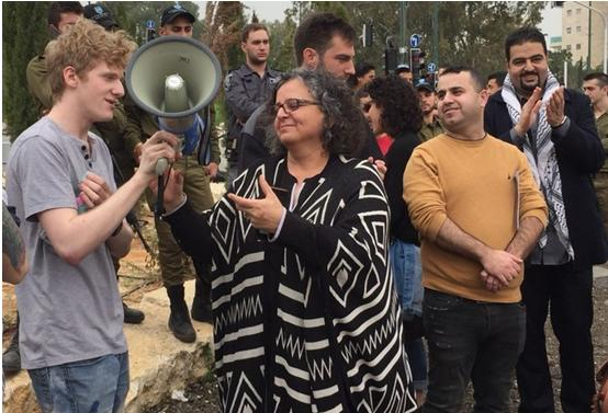 MK Aida Touma-Sliman and draft refuser Saar Yahalom (on the left) at the protest outside the Israeli military induction base on Sunday. To Touma-Sliman's right, hands folded, is Arafat Badarneh, General Secretary of the Young Communist League in Israel.
