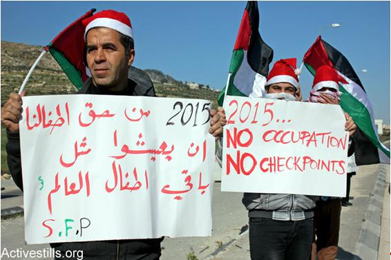 "Palestinians at the Huwwara checkpoint demonstrate against unaccountable military violence. The sign in Arabic reads: ""It is our children's right to live just like all the other children of the world."""