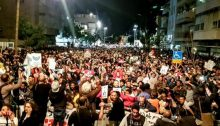 More than 20,000 demonstrated in south Tel Aviv against the deportation of African refugees and asylum seekers, February 24, 2018.