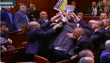 "Ushers brawl with Joint List lawmakers to take away the latter's signs declaring ""Jerusalem is the capital of Palestine"" before ousting them from the Knesset plenum during US Vice President Mike Pence's speech in Jerusalem on January 22, 2018."