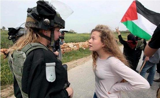 Ahed Tamimi confronts an Israeli soldier in Nabi Saleh.