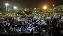 Tens of thousands of demonstrators gathered in Tel Aviv's Rabin Square on Saturday night, March 24, to protest the government's racist plan to deport African refugees and asylum seekers.