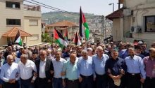 Palestinian-Arab citizens of Israel demonstrate en masse in the Galilean city of Sakhnin to protest the second consecutive Friday massacre of civilians along the Gaza border by the Israeli army, Saturday April 7, 2018. Among the protestors were former Hadash MK, Mohammad Barakeh, chair of the High Follow-Up Committee for Arab Citizens of Israel (third from left) and (third from right) Hadash MK Yousef Jabareen.