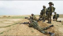 Israeli snipers take aim at protesting Palestinian near the Gaza security fence.