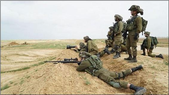 Israeli snipers, one take aim at protesting Palestinian, near the Gaza security fence